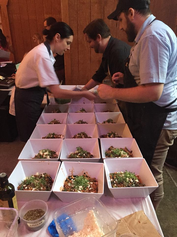 chefs prepping the next plated course