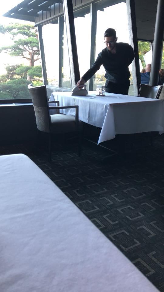 Ironing table cloth at Canlis