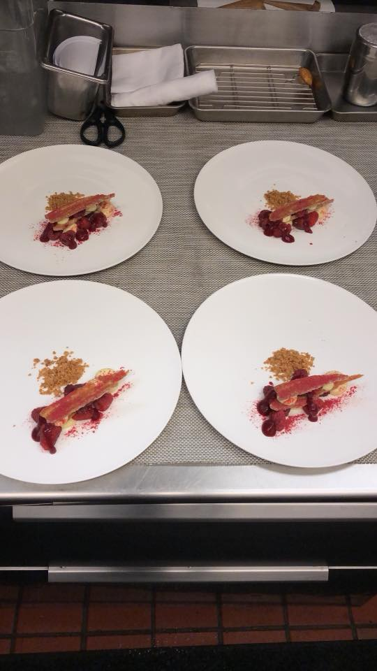 plating the dessert course in the kitchen at Canlis