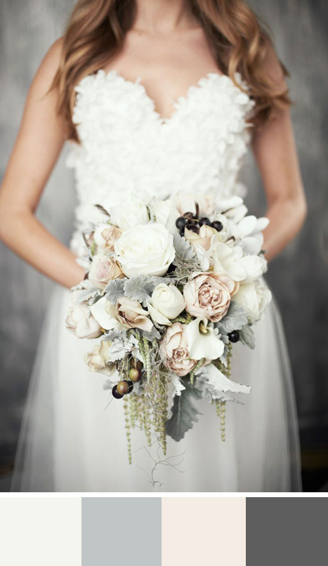 bride holding grey and cream bouquet