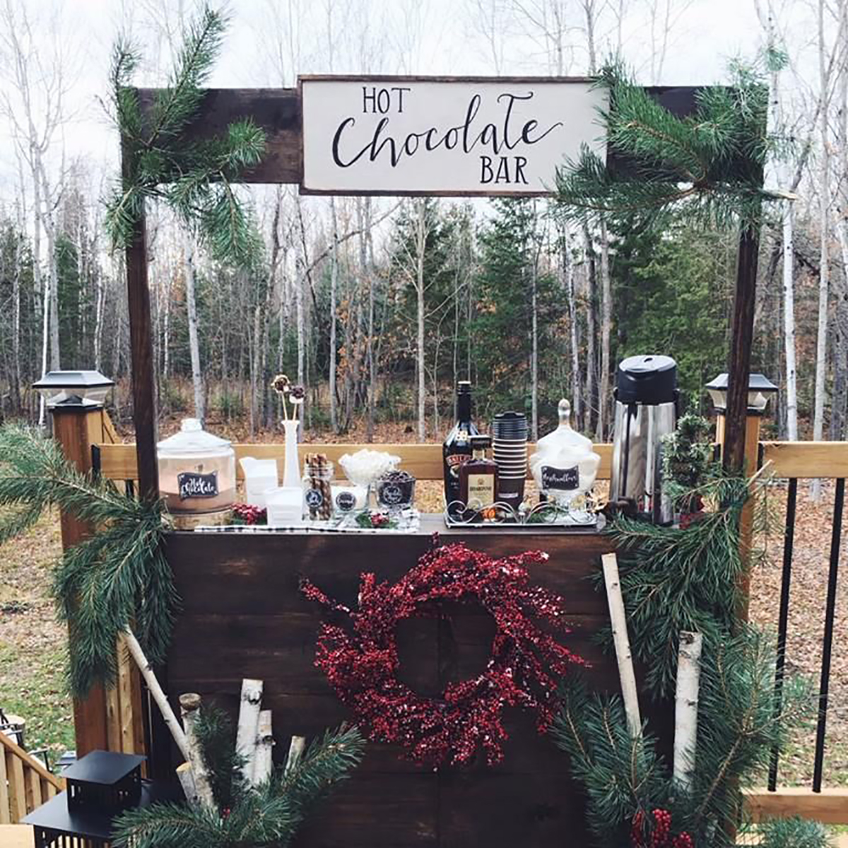 outdoor hot chocolate bar with wreath