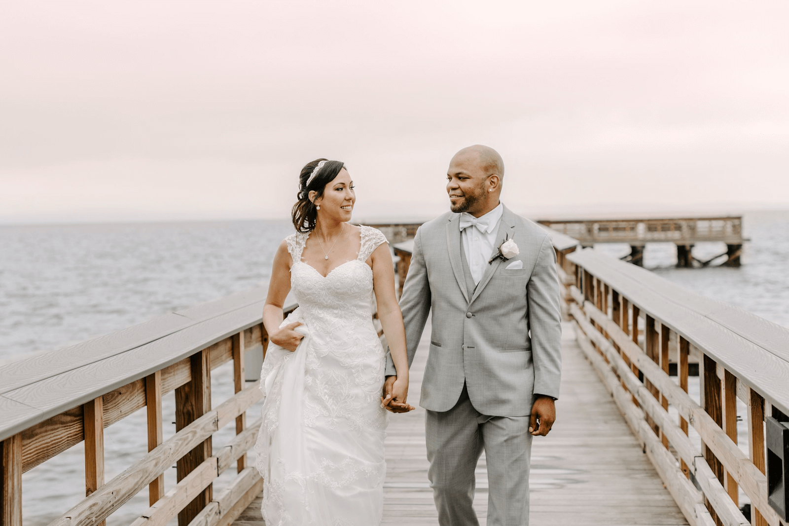 wedding couple walking on harbor