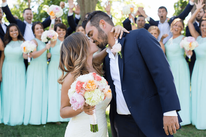 Matapeake Beach and Clubhouse wedding couple kissing