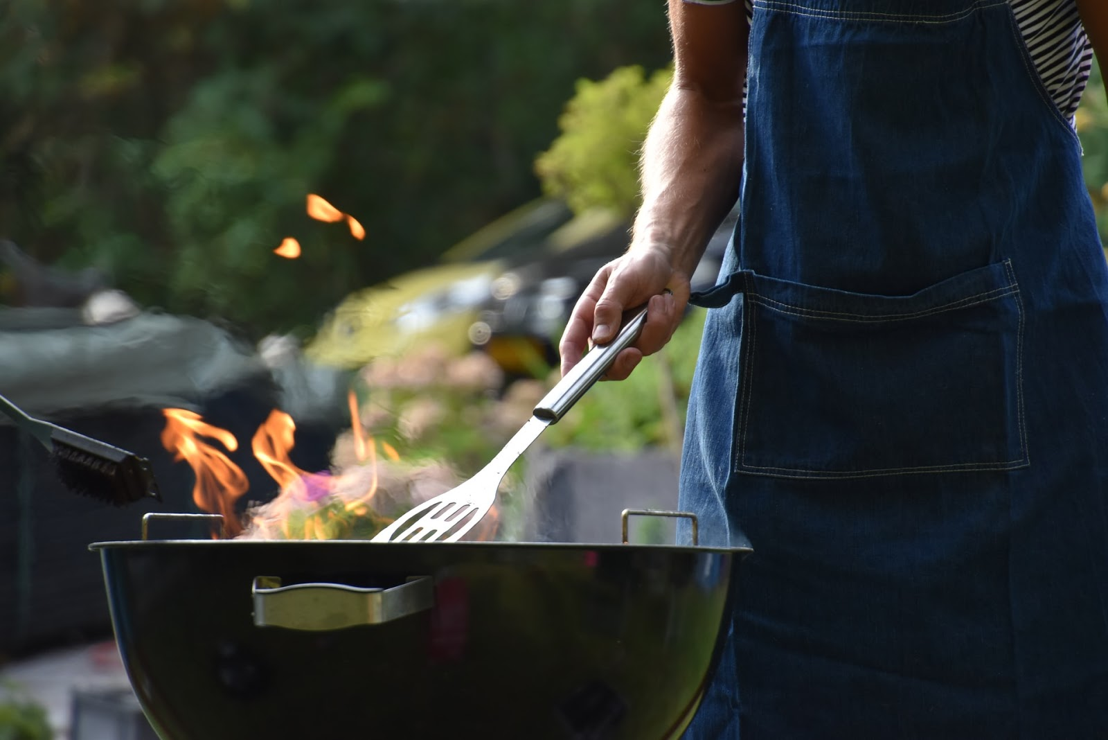man cooking barbecue