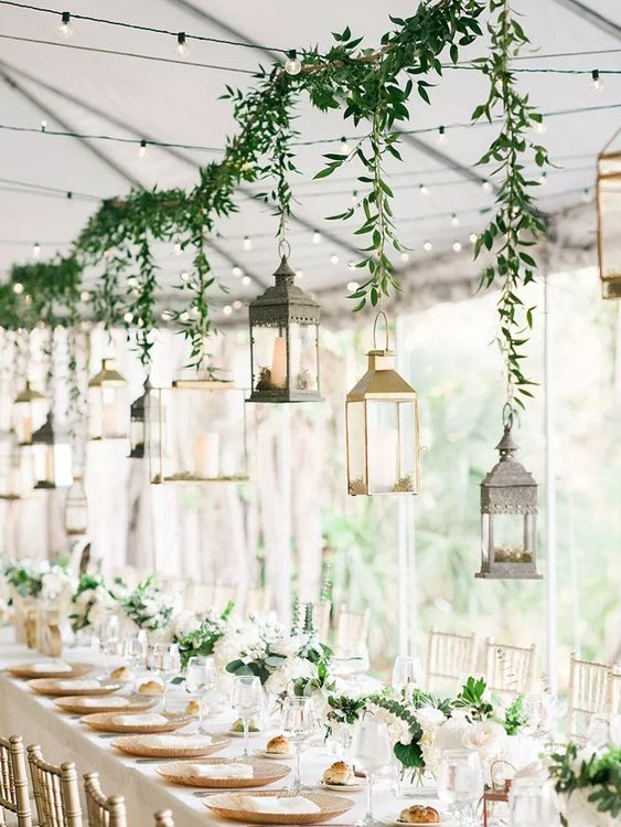 photo via countryliving.com, lanterns hanging above guest tables