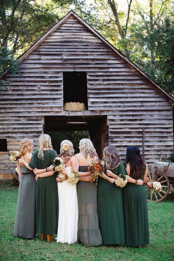 photo via RusticWeddingChic.com, bridesmaids in green dresses posing with bride