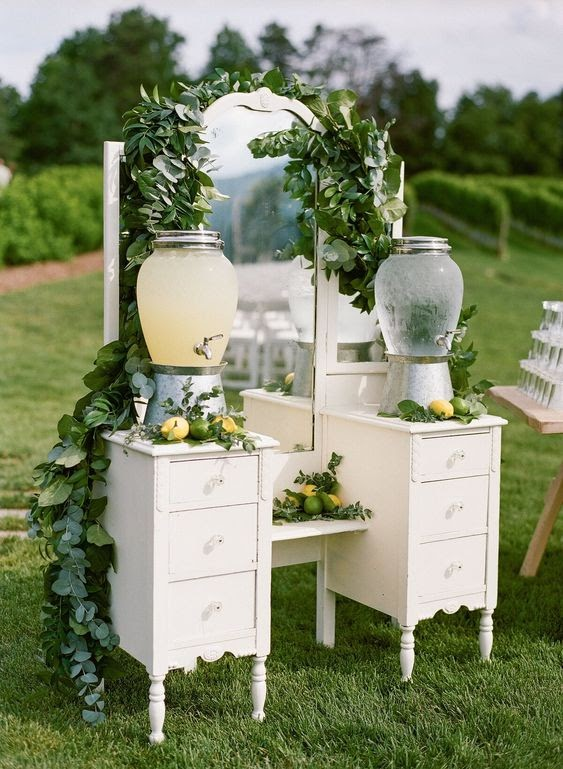 Drinks placed on a vintage dresser, photo via marthastewartweddings.com