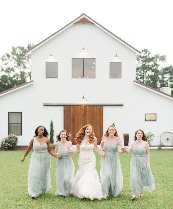 Bridal party in front of Wildflower Estate, photo via weddingwire.com