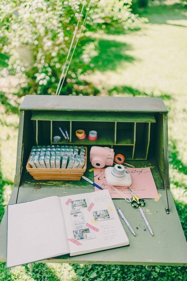Polaroid guest book. photo via mywedding.com