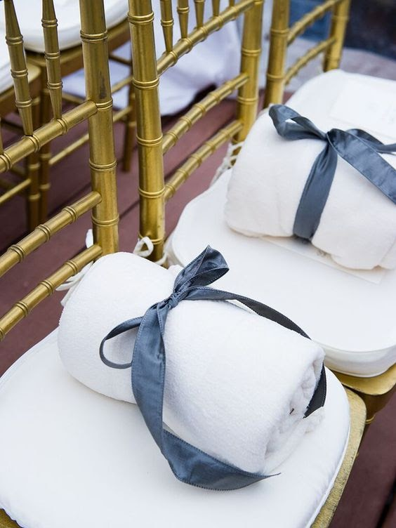 Blanket gift favors on guest chairs. photo via theknot.com