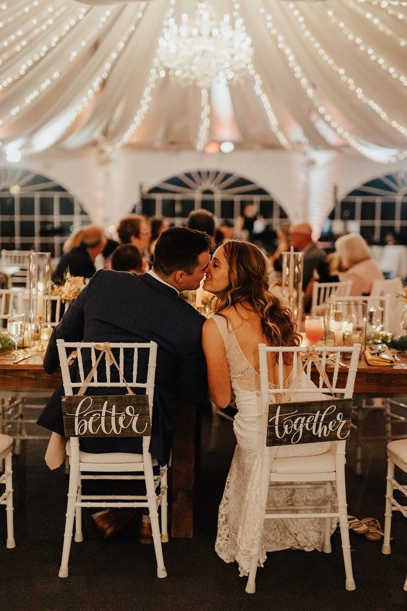 Couple sitting at table and kissing photo via herringtononthebay.com