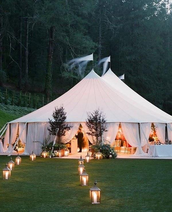 Entrance of a tented wedding. Photo via emmalovesweddings.com