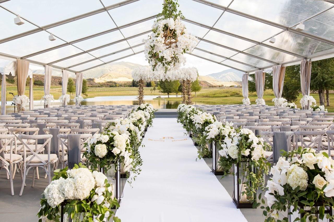 a tented wedding ceremony. photo via insideweddings.com