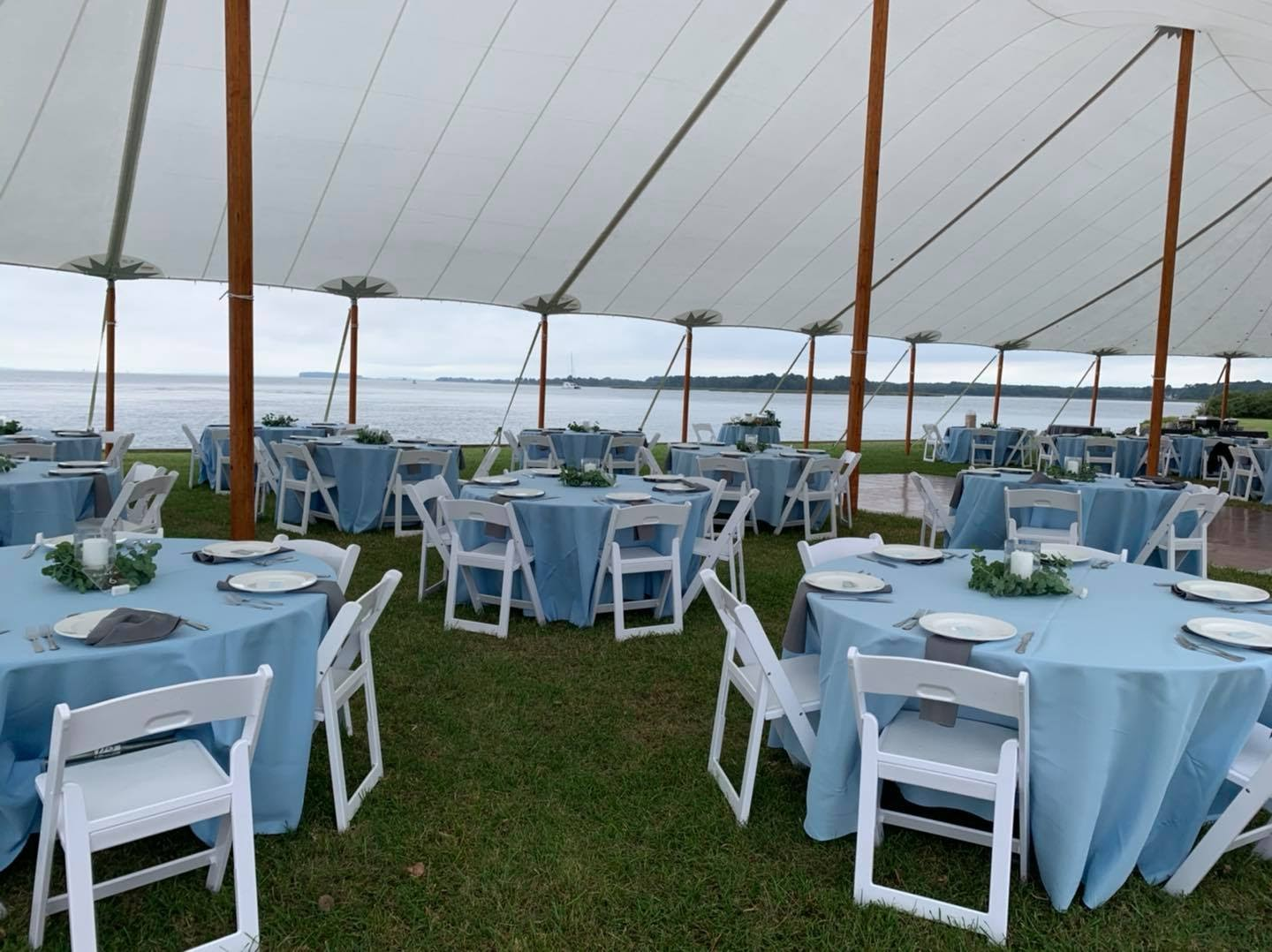tent reception seating near the water