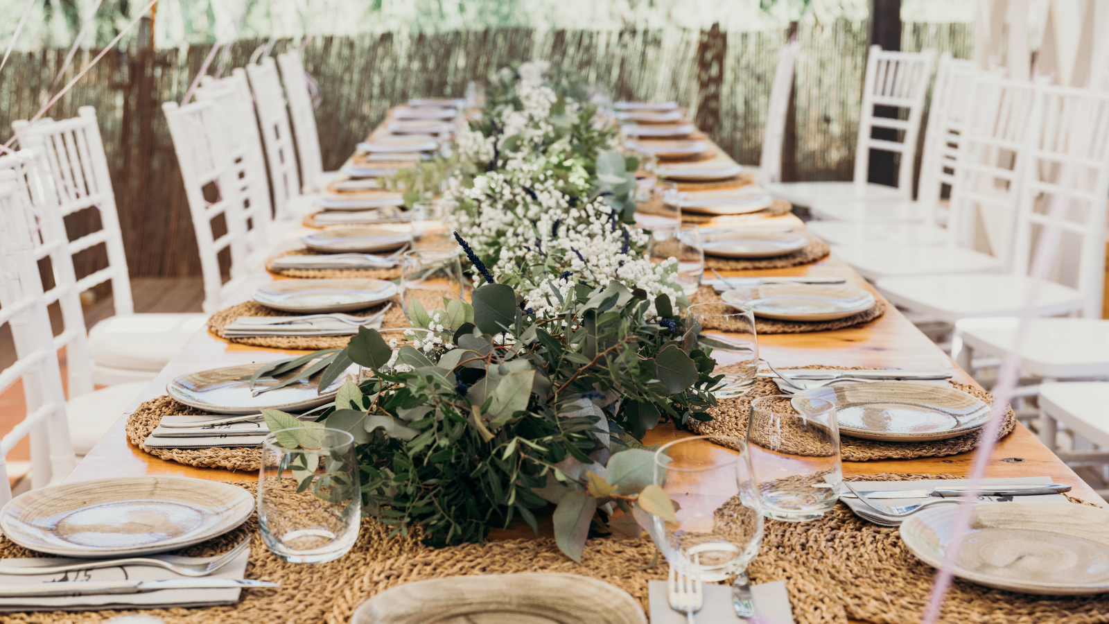 wedding reception table setup with silverware and china