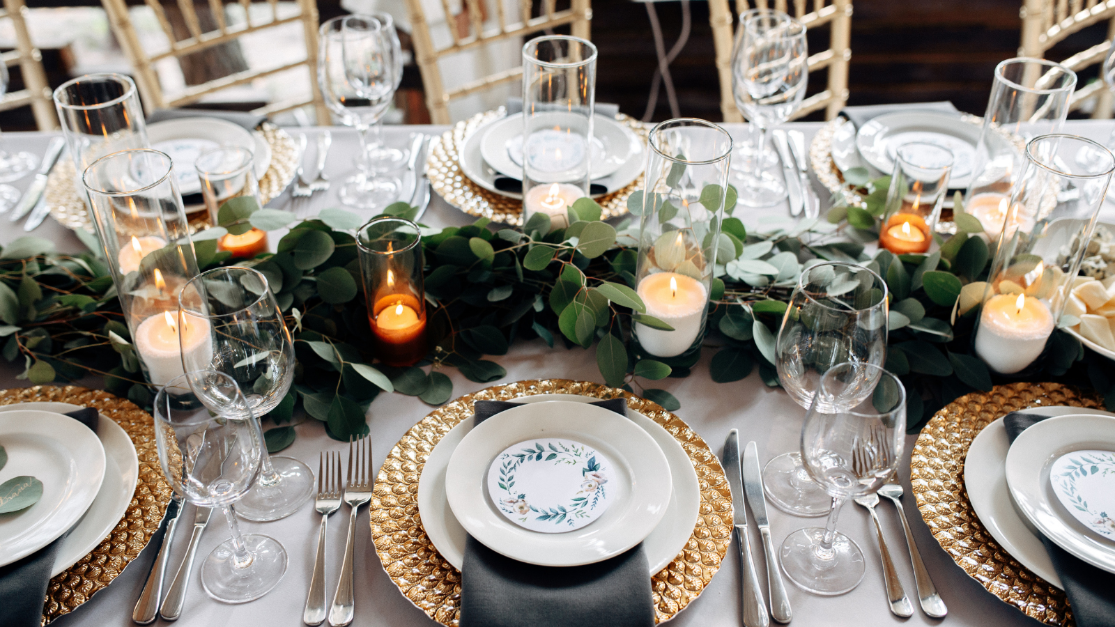 wedding reception setup with china, silverware, and centerpieces