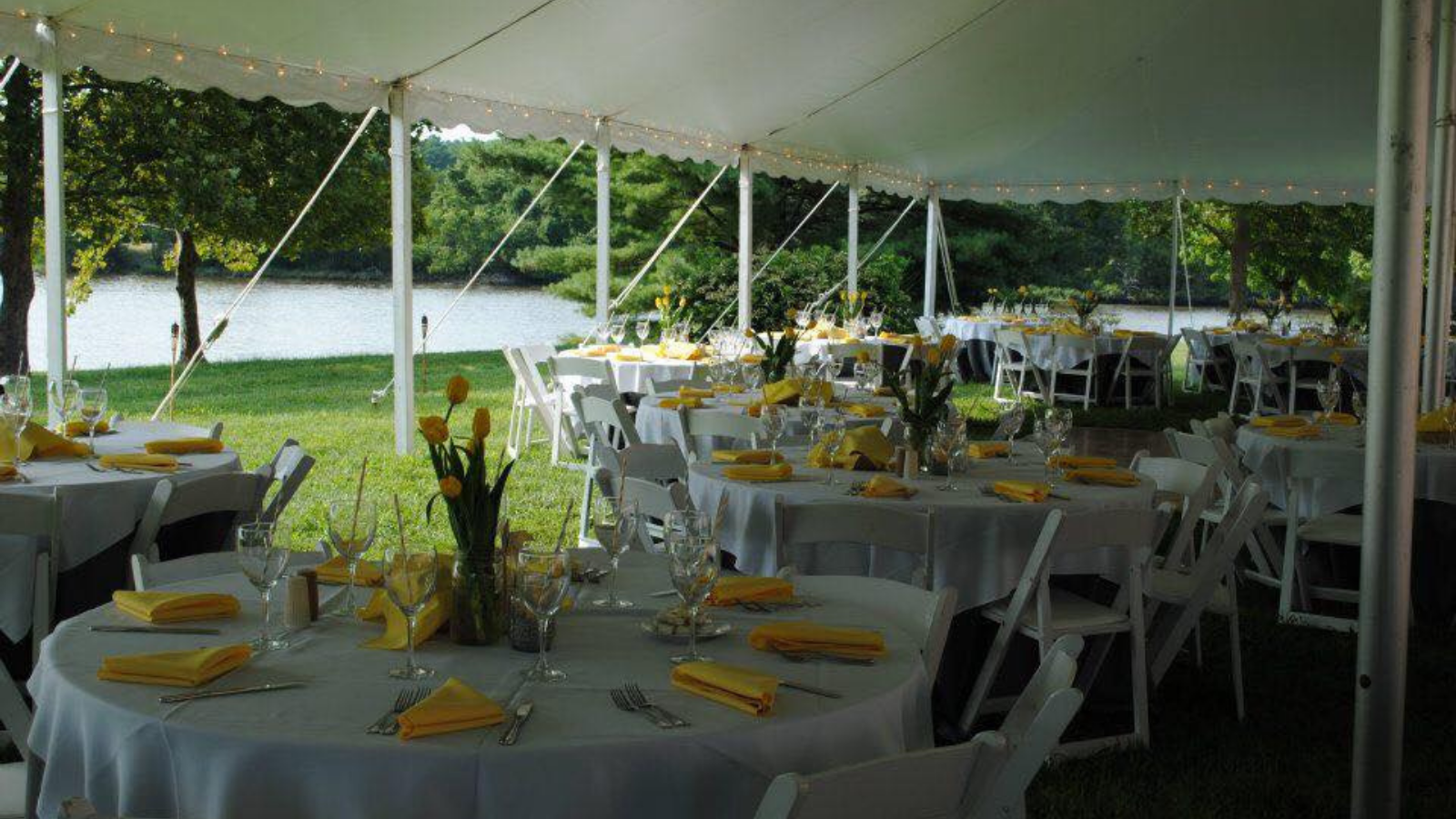 One of many outdoor wedding venues catered by the Smokehouse Grill with yellow accents