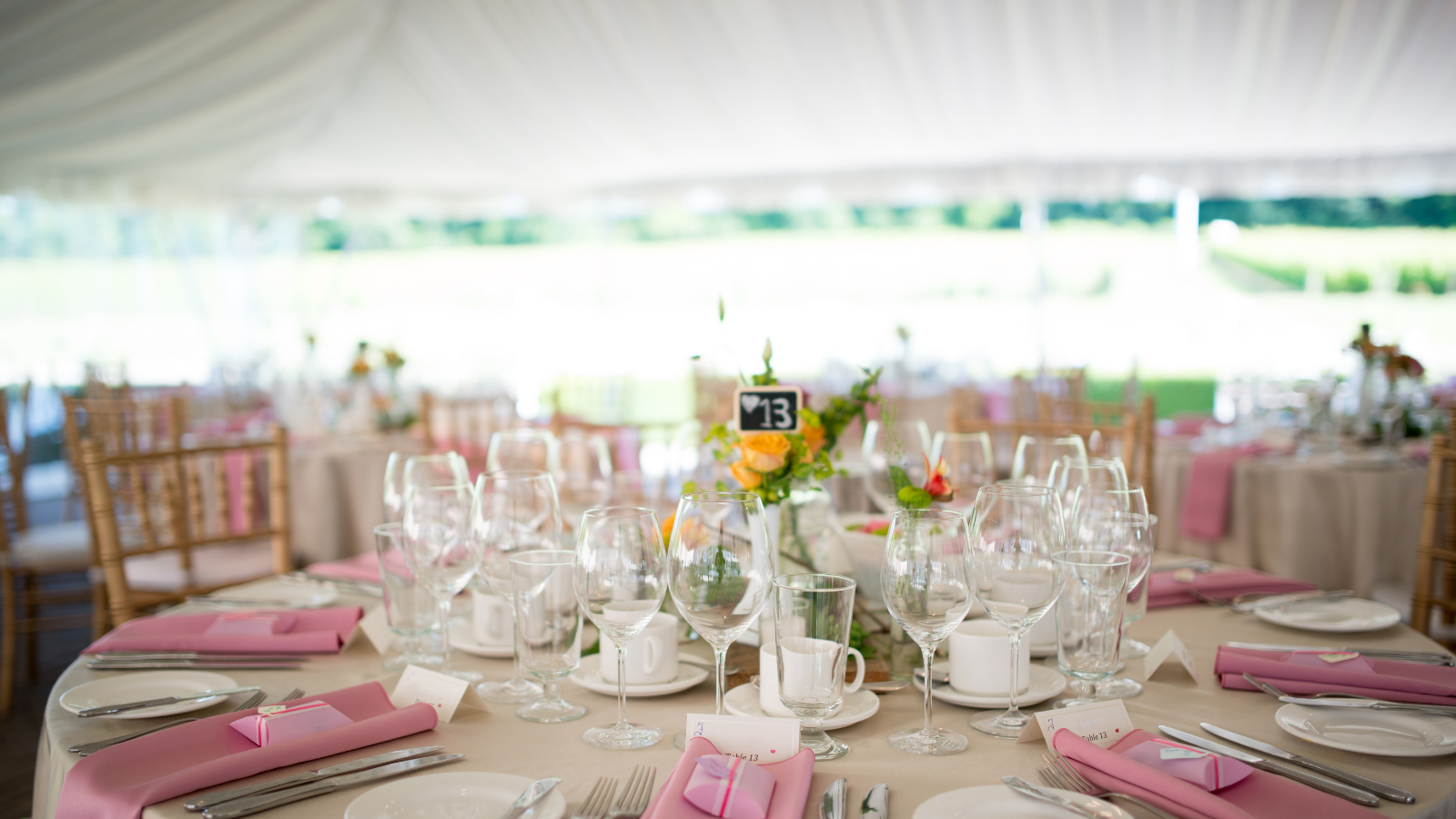 closeup of a tented wedding reception's tables