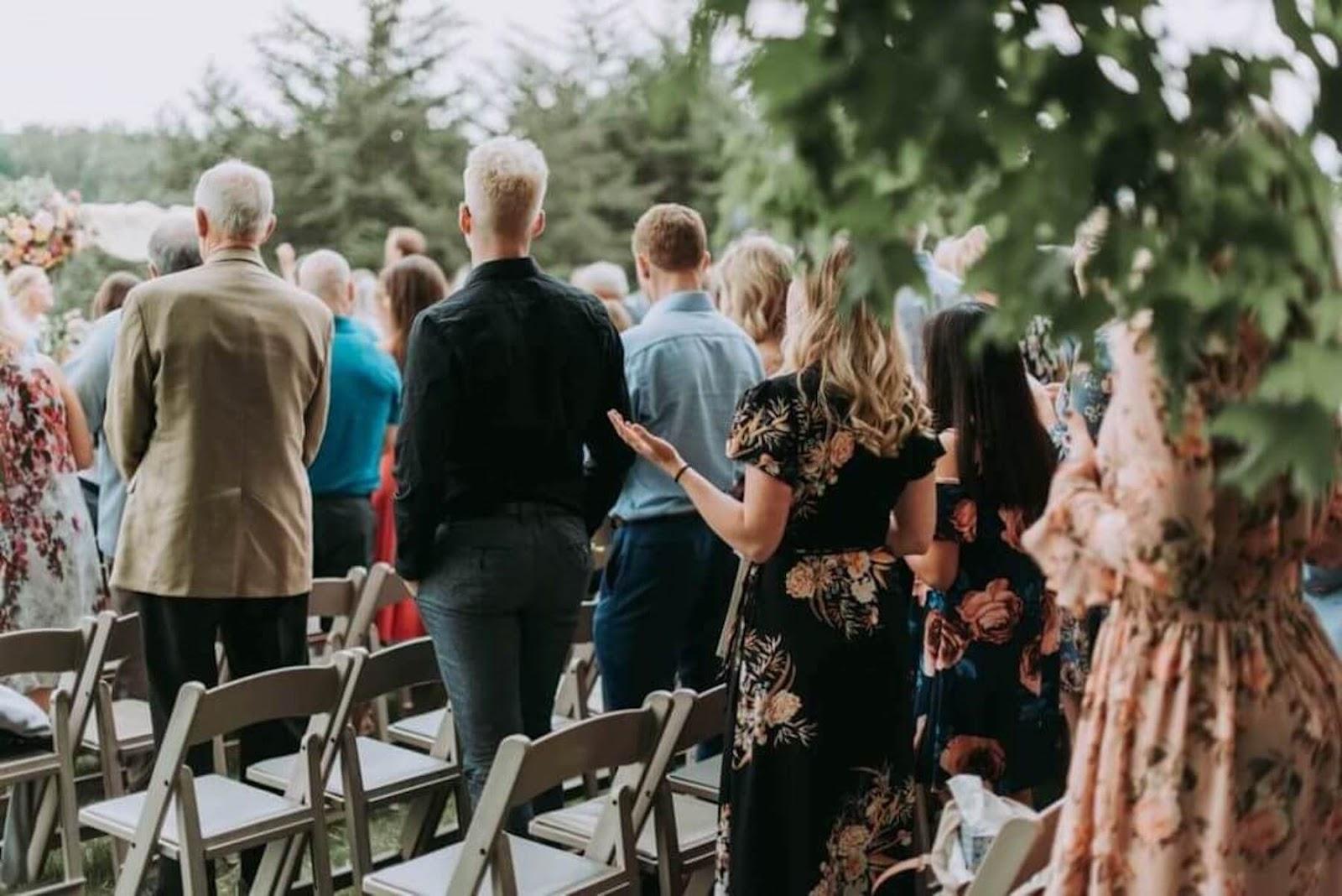 wedding guests standing