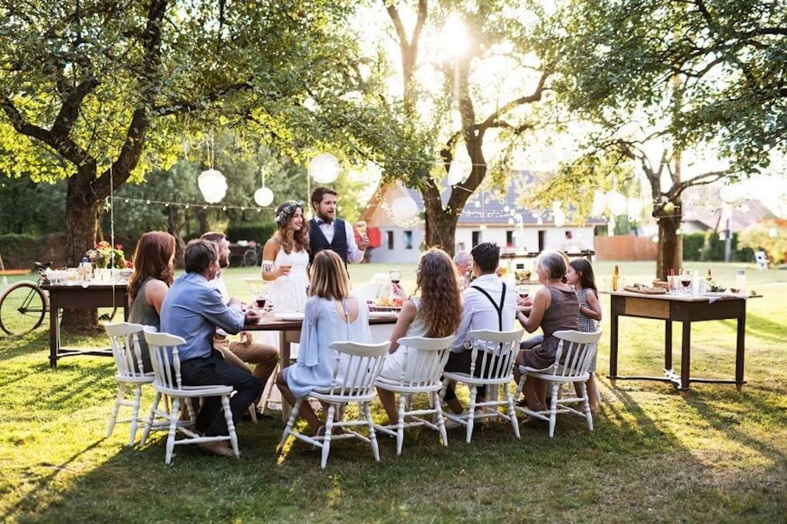 small wedding party sitting at a table
