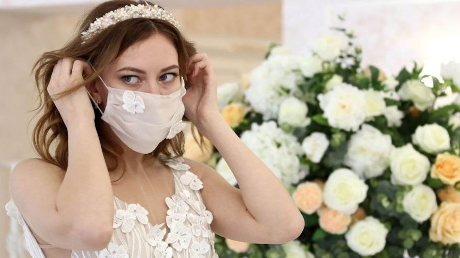bride putting on a face mask
