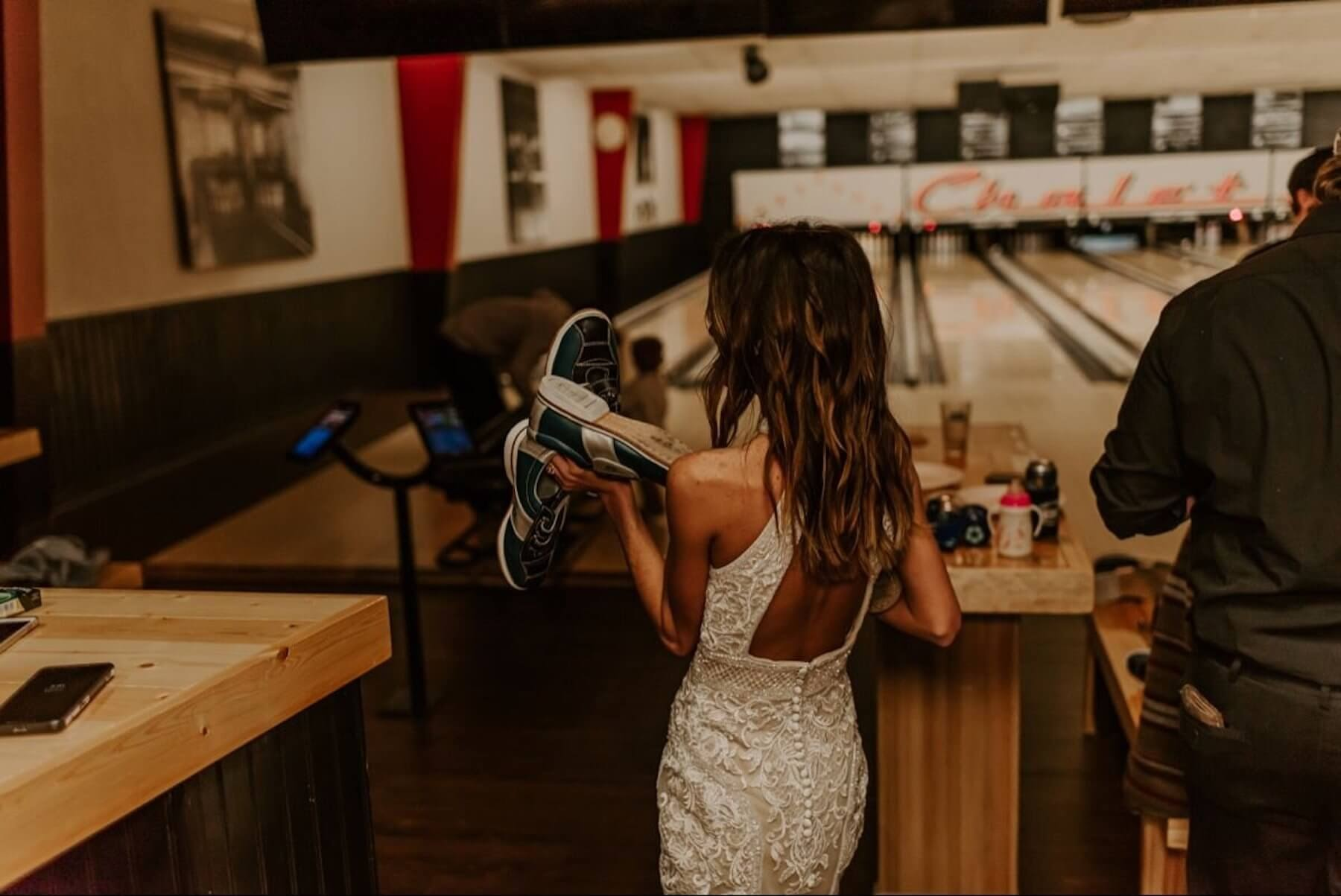 bride at a bowling alley