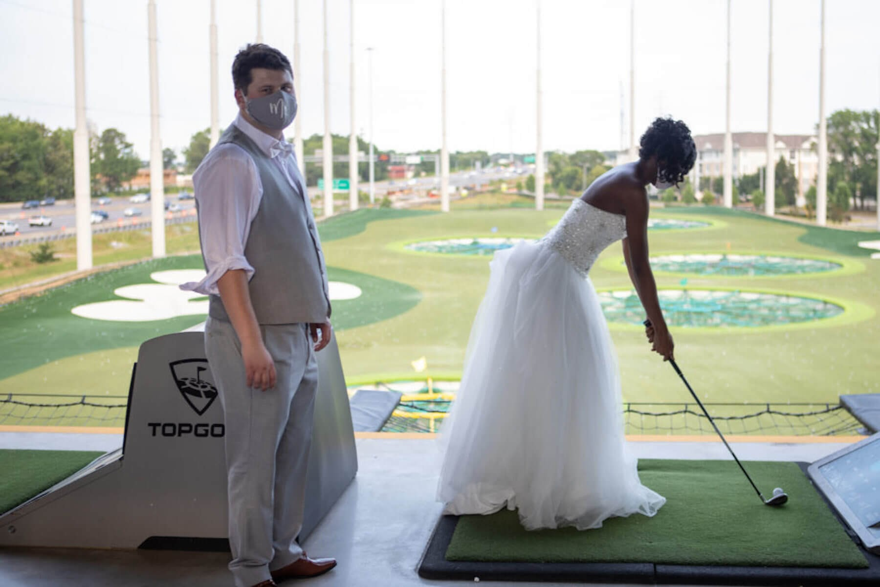 bride and groom at topgolf