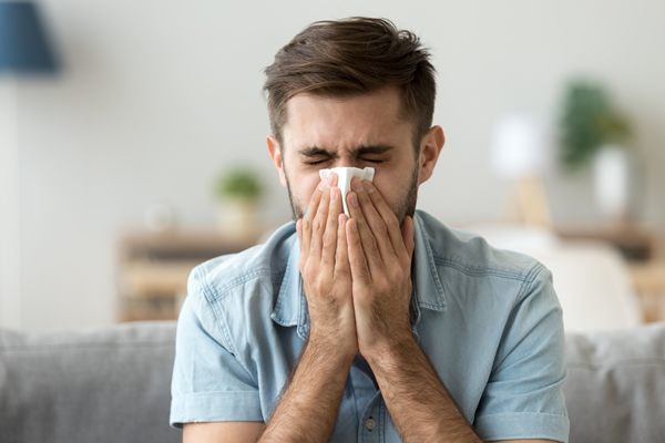 man suffering from sinus infection