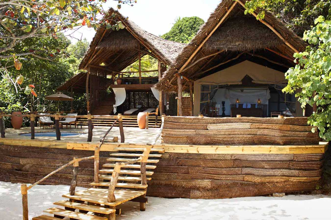 The main hotel is built under thatch and is large and airy and overlooks the sea.