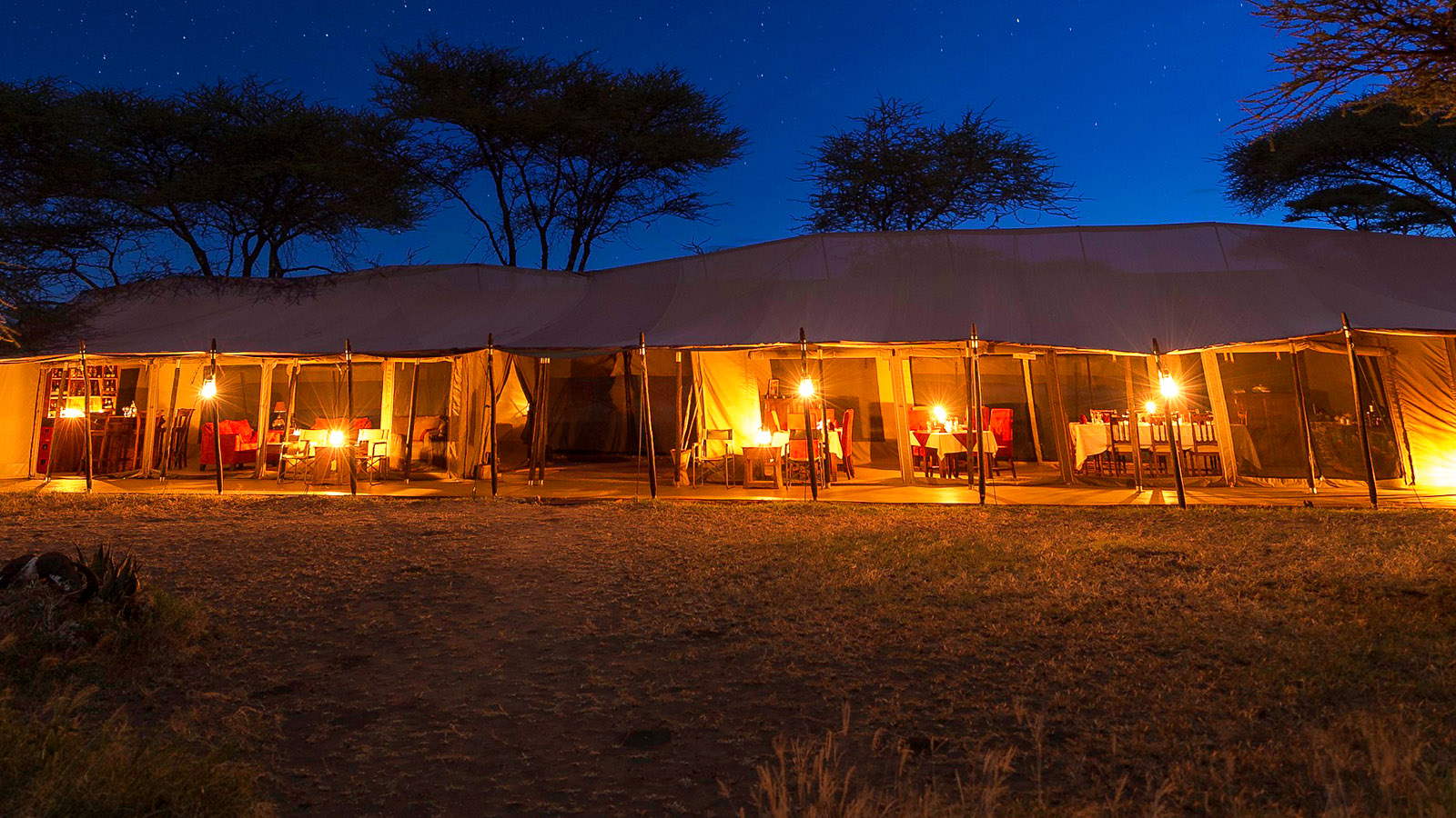 Situated near the famous Barafu and Sametu Kopjes, the camp boasts quiet seclusion, panoramic views of the wide open savannah plains and the Ngarenanyuki River meandering near the edge of camp.