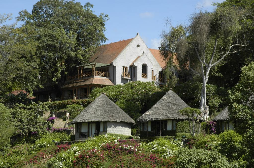 Nestled at the foot of the wooded slopes of Mount Meru, this unique hotel in Arusha Tanzania stands amid coffee plantations on the shores of tranquil Lake Duluti.