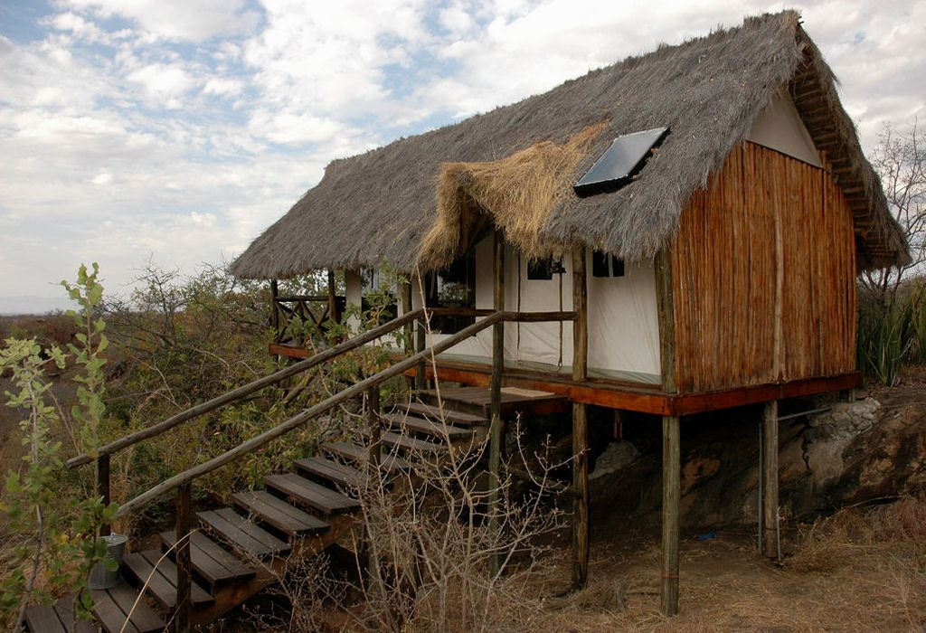 "The camp is located in the north-western area of Tarangire National Park and is built on top of a massive ""kopje"" (granite rocks)"