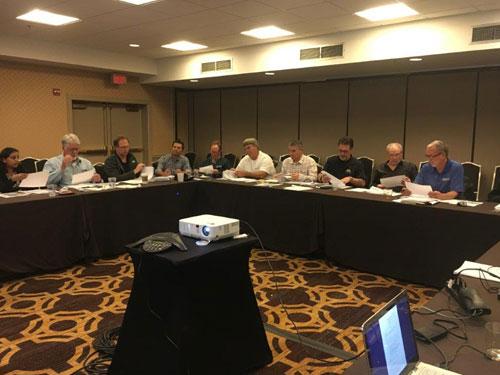 Members at important meeting