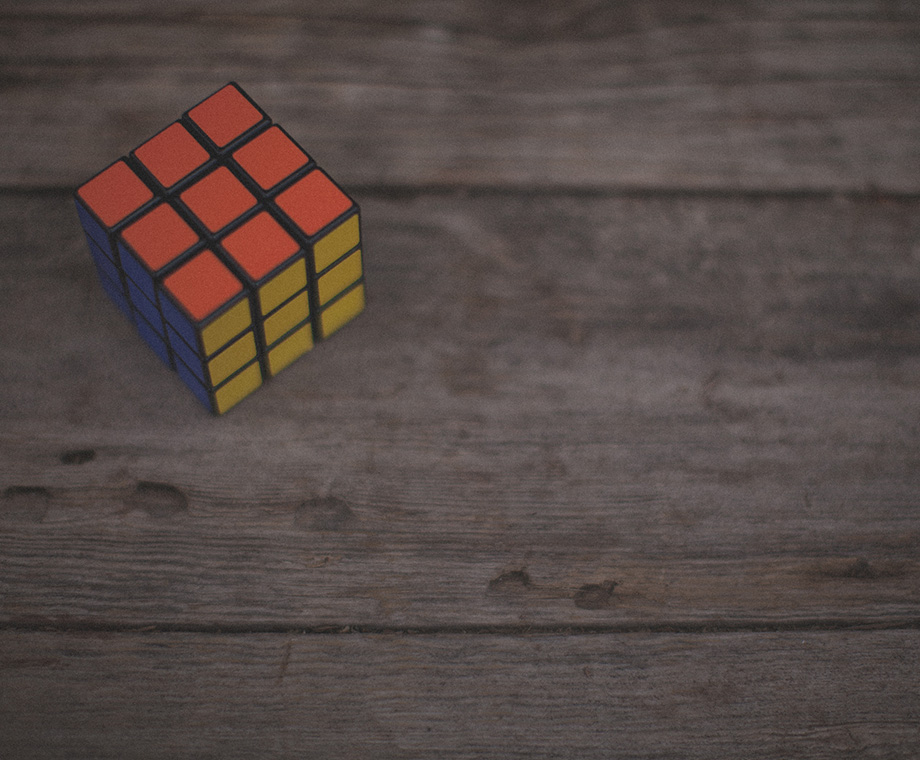 rubik's cube on a wooden table