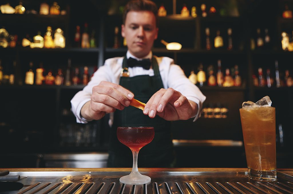 bartender preparing a mixed drink