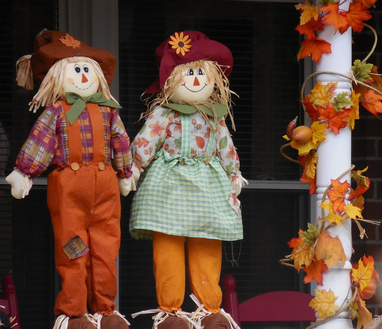 two small smiling scarecrows