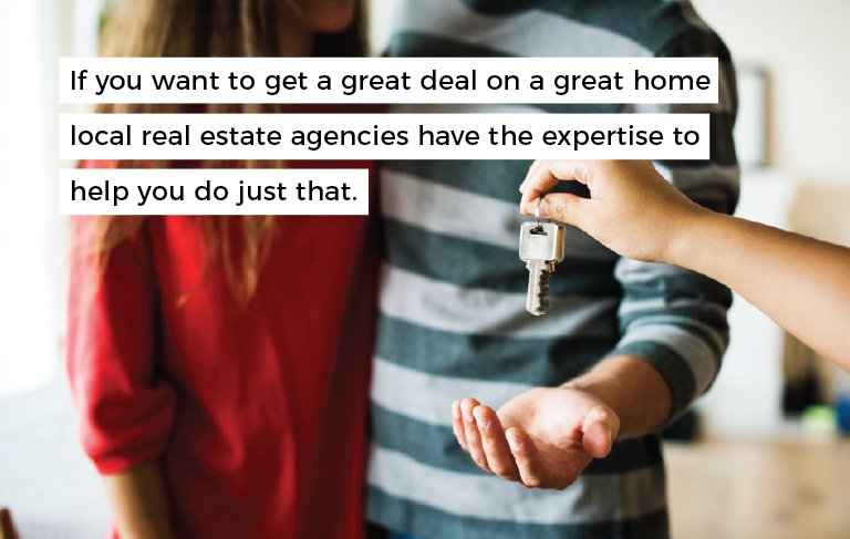 "hand holding a young couple a pair of keys with overlaying text that reads ""if you want to get a great deal on a great home local real estate agencies have the expertise to help you do just that"""
