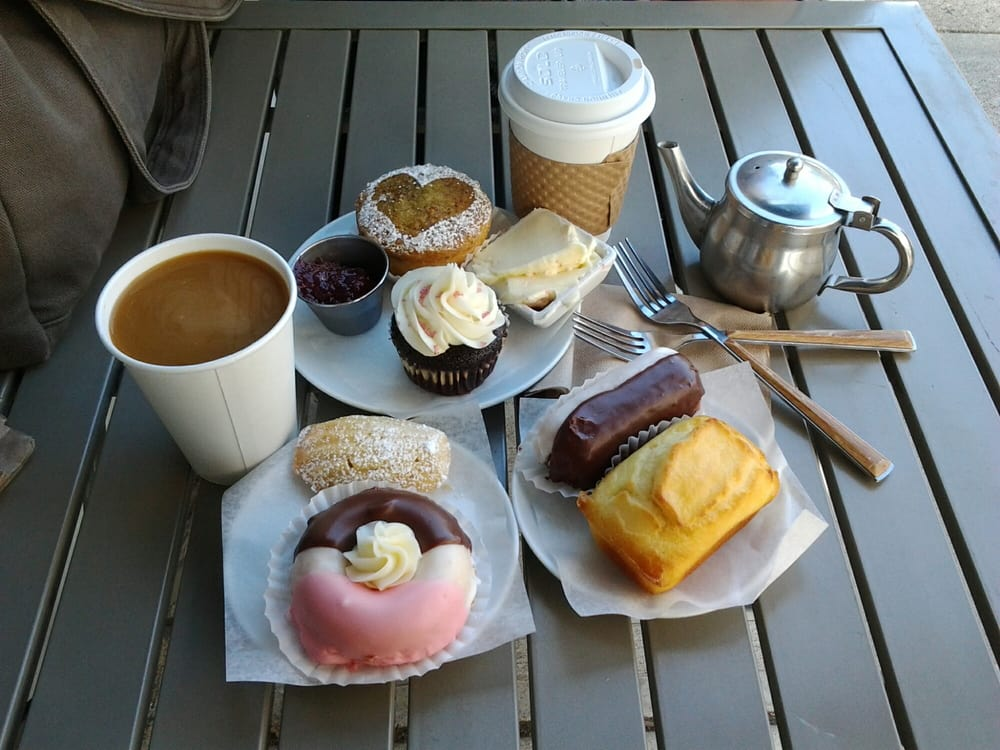 table with coffee, donuts, cupcakes, and other Cherbourg Bakery items