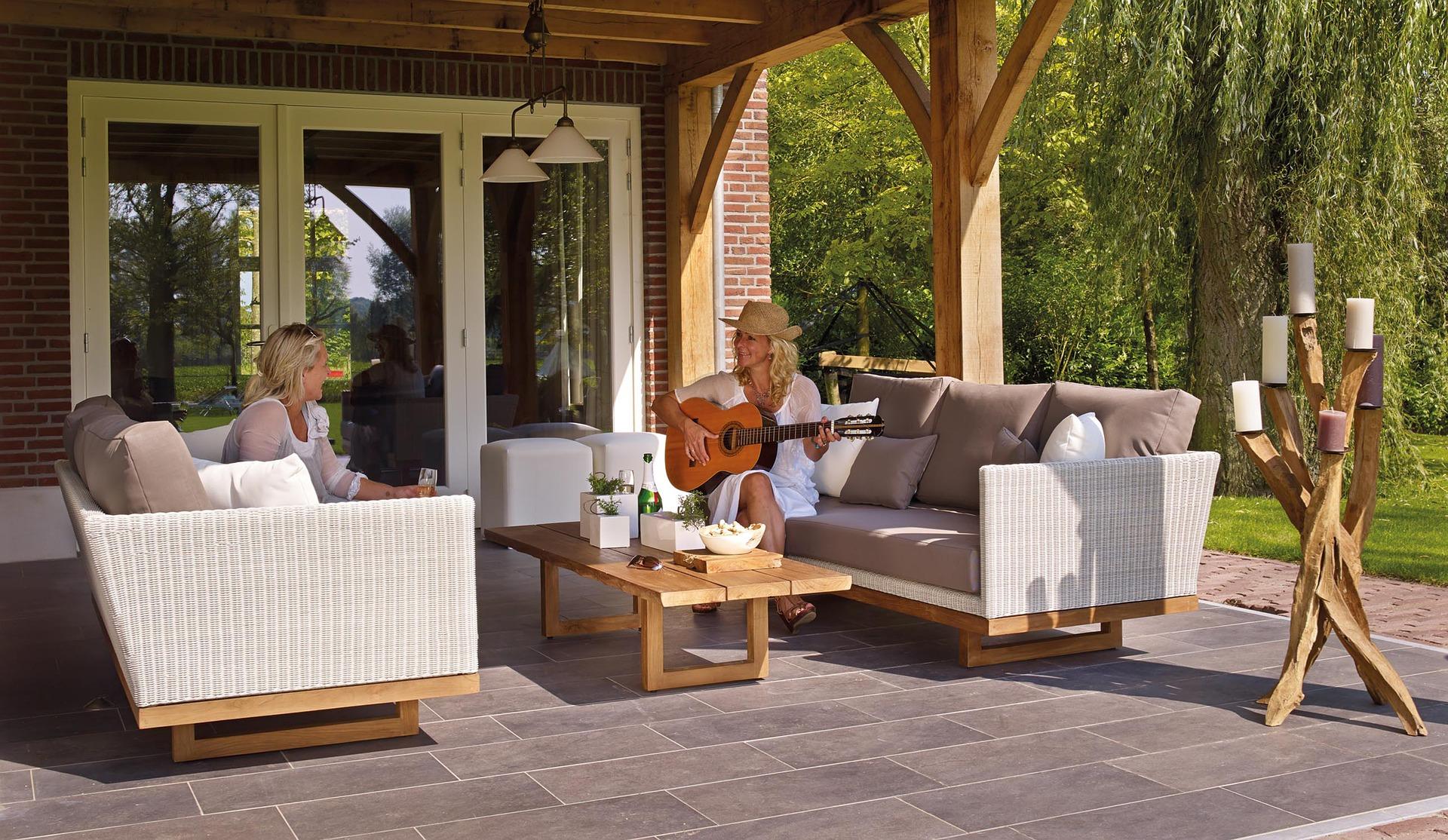 "women sit in modern ""living room"" patio"