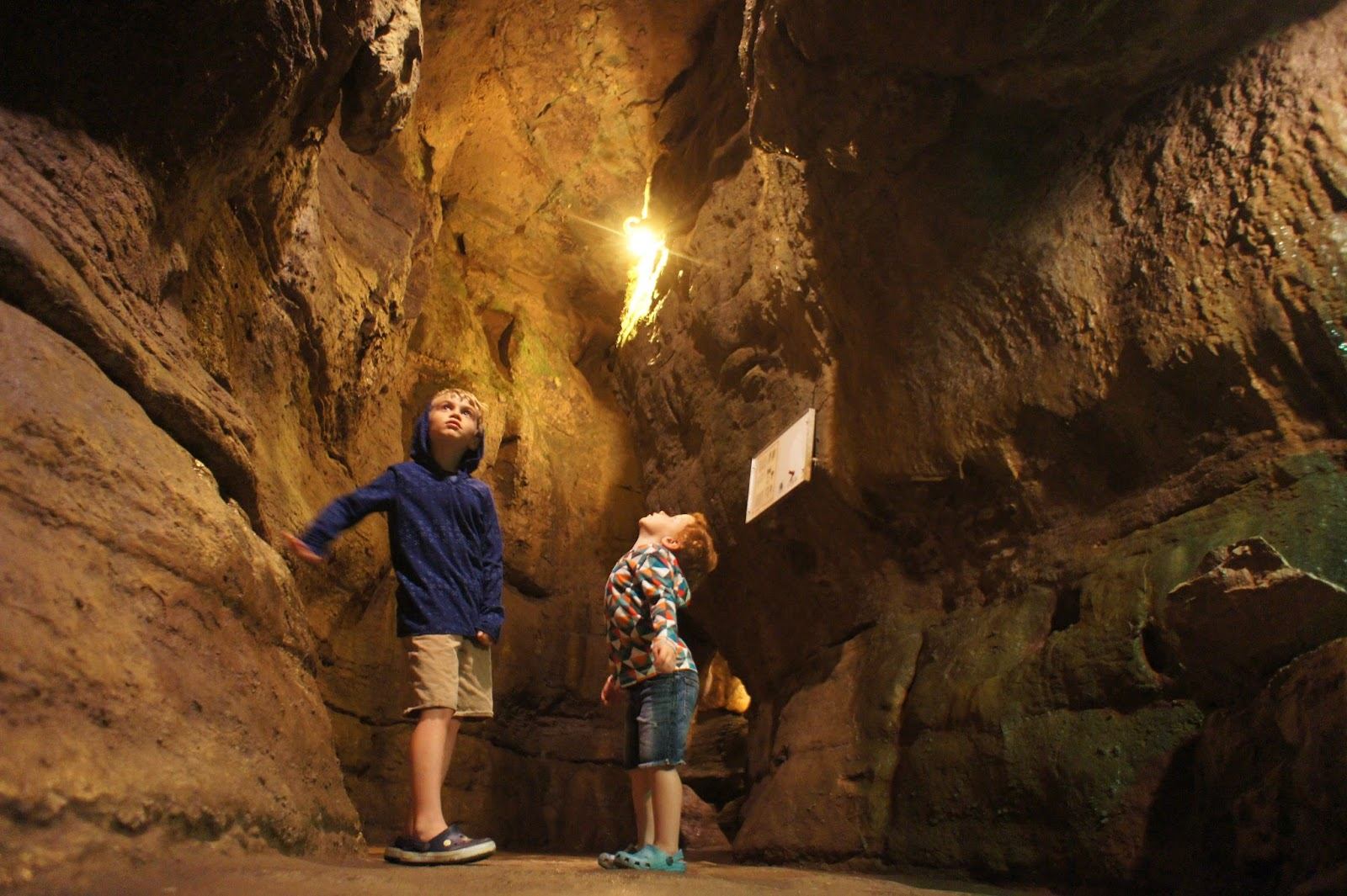 two young boys in a cavern