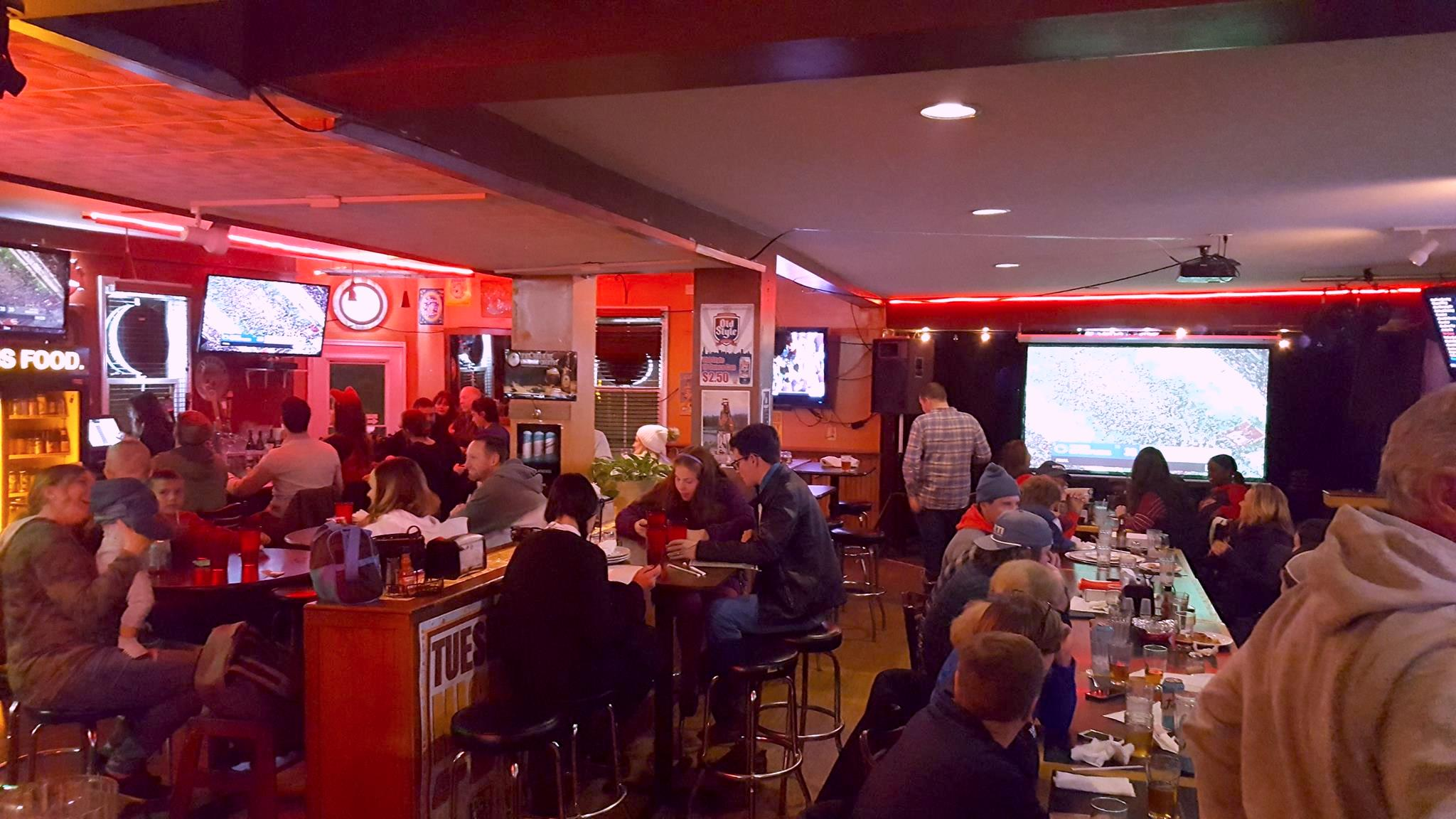 people drinking & dining inside South Park Tavern
