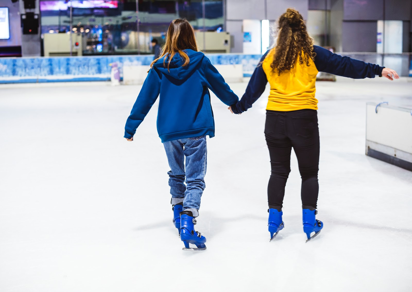 ice skaters in rink skating during open skate