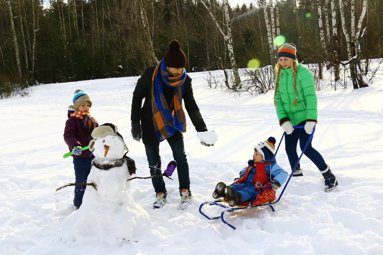 family doing outdoor winter activities