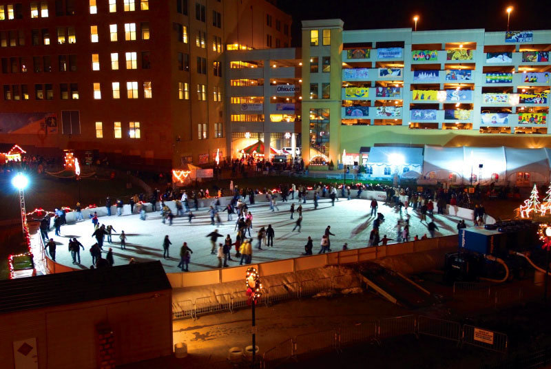 people skating outdoor in Lock 3 ice rink in the evening