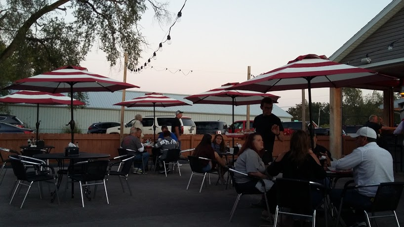 people eating outside at Woody's Diner