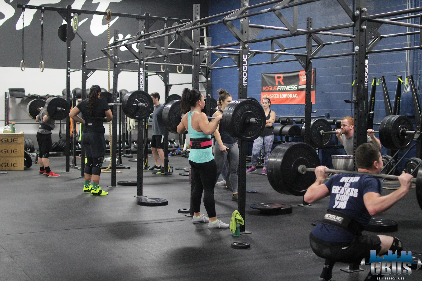 Group of athletes power squatting