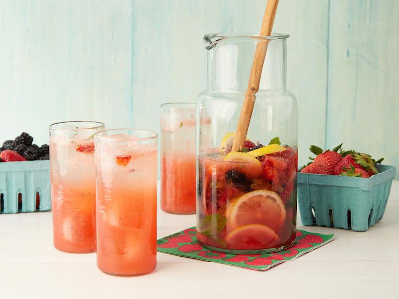 pitcher and three glasses of Muddled Lemonberryade