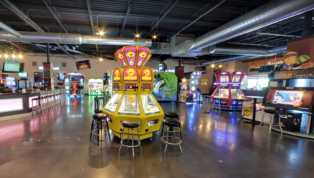 Arcade games and bar in large warehouse