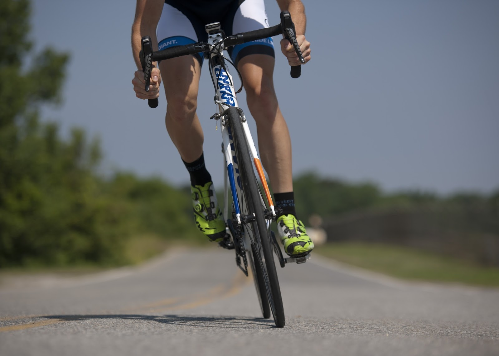 man biking down the road