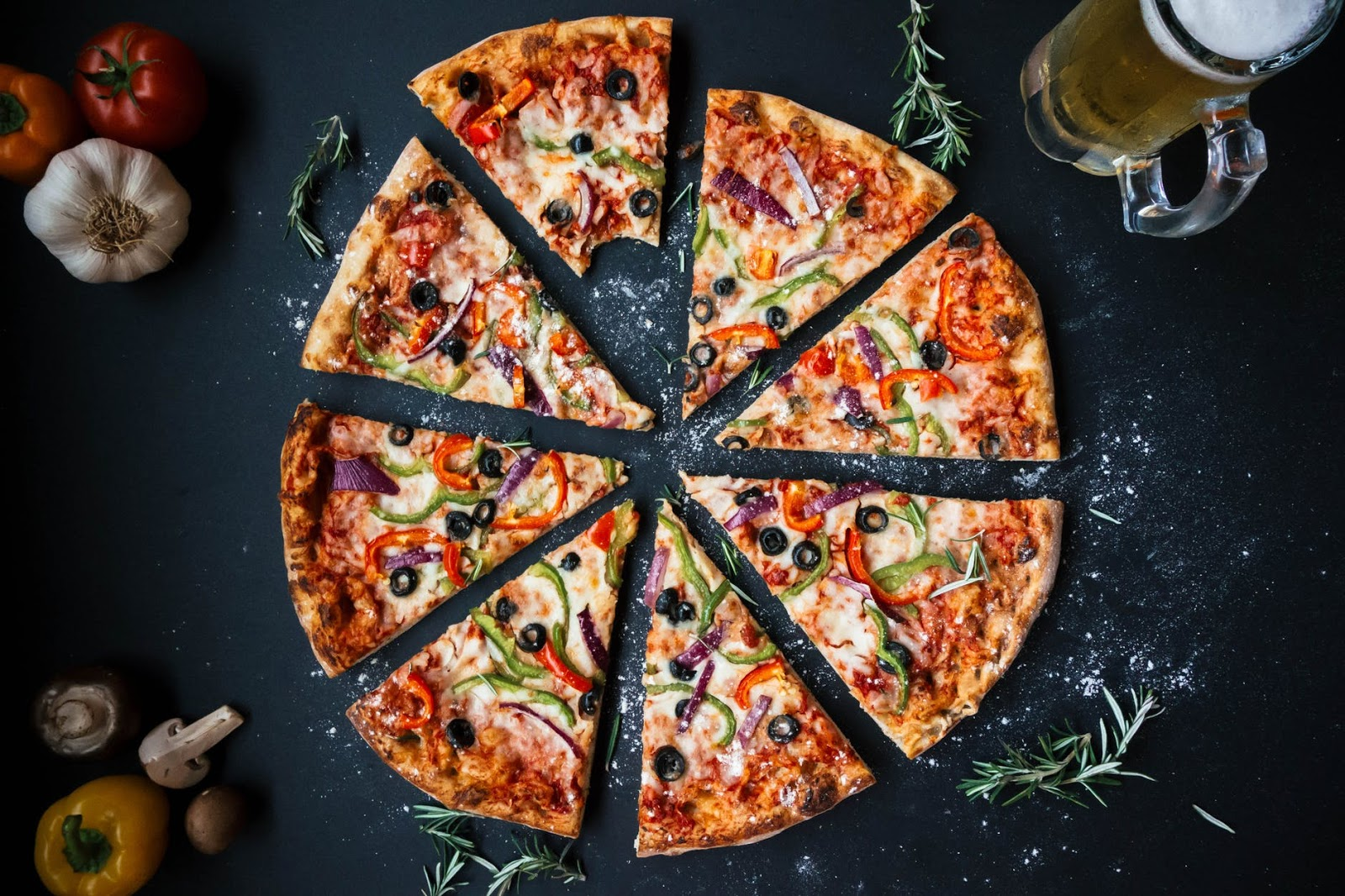 overhead view of a pizza cut into slices
